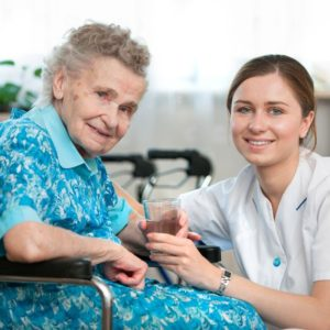 14298413 - senior woman with her caregiver at home