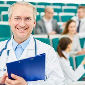 Senior medicine professor or lecturer in university medical school hall